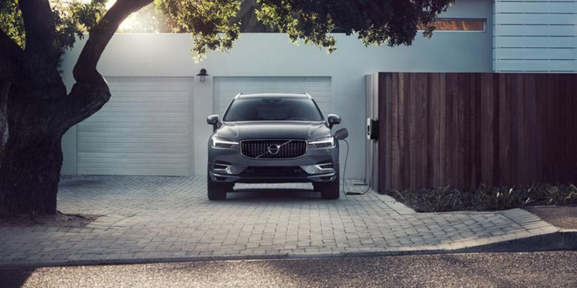 Photo of Volvo BEV charging in front of garage